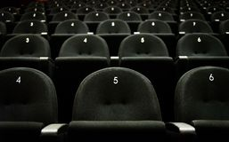 Inside of auditorium movie theatre with seats and numbers. Royalty Free Stock Photos