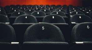 Inside of auditorium movie theatre with seats and numbers. Royalty Free Stock Photography