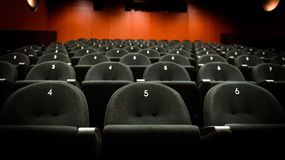Inside of auditorium movie theatre with seats and numbers. Royalty Free Stock Photo