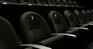 Inside of auditorium movie theatre with seats and numbers. Stock Photography