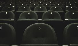 Inside of auditorium movie theatre with seats and numbers. Stock Photo