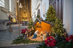 Traditional old Christmas crib. Inside Augustinian Church Augustinerkirche with christmas decoration in Vienna, Austria royalty free stock photos