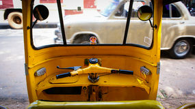 Inside an autorickshaw. The view from behind the handlebars of an auto-rickshaw in Madurai, India Royalty Free Stock Image