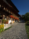 Inside Barsana Monastery. You will meet a very warm place full of flowers and traditional architecture from Maramures county Stock Photos