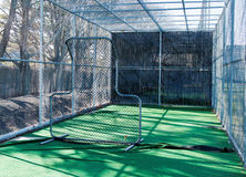 Inside a baseball batting cage. The view from inside a baseball batting cage from behind the pitching screen Royalty Free Stock Image