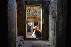 Inside bayon temple with tourist in holiday stock photo