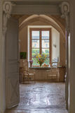 Inside a beautiful old home, looking to the kitchen and garden beyond Royalty Free Stock Photos