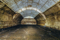 Inside big rusty underground abandoned fuel tank for refueling diesel submarines at repair factory royalty free stock image