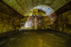 Inside big rusty underground abandoned fuel tank for refueling diesel submarines at repair factory stock photography