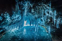Inside the blue ice cave with couple love at Lake Baikal, Siberia, Eastern Russia.  royalty free stock image