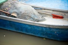 Inside boat with fishing net royalty free stock image