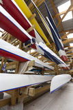 Inside a Boathouse. Low, wide-angle view of boats stored inside a rowing club boathouse Royalty Free Stock Images