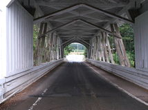 Inside the bridge. Looking down the interior of a covered bridge showing the unique architecture and design. Has wide open areas on the sides stock photo