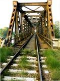 Inside the bridge. Rusty old bridge and railroad tracks Stock Photography