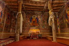 Inside a Buddhist temple in Spiti Valley. Inside View of very old Buddhist temple in Spiti valley. Walls are covered with paintings and structure is mostly wood stock image