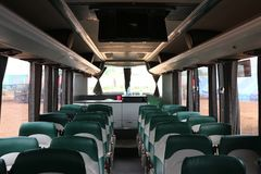 Inside the cabin, a large bus, beautiful design, with colorful seat cushions royalty free stock photography