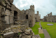Inside Caernarfon Castle. Ancient Castle is located in Gwynedd, northwest, Wales. This castle placed on a Royal town, received hundreds of tourists daily Royalty Free Stock Photo