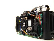 Inside camera. Isolated photograph of a compact film camera with flash. Critical focus is on a lens stock photo