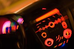 Inside of a car. Blurred slow shutter photo from inside of the car with the dials and dashboard controls illuminated Stock Photography