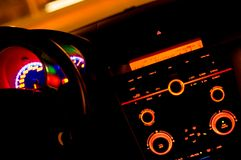 Inside of a car. Slow shutter photo from inside of the car with the dials and dashboard controls illuminated Royalty Free Stock Photos