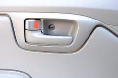 Inside car door lock beige color close up. Royalty Free Stock Photo