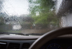 Inside the car. Driving on the road during the rain. Royalty Free Stock Images