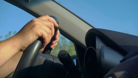 Inside a Car. A Man`s Hands on the Steering Wheel Royalty Free Stock Images