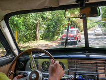 From inside the car to the road. Old Cuban automobile driven by cuban person. Really old cars that are still on the road Royalty Free Stock Photos