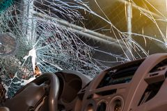 In the car, the steering wheel bent from the accident. Stock Photos