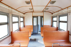 Inside of carriage of electric train. With wooden benches Stock Image