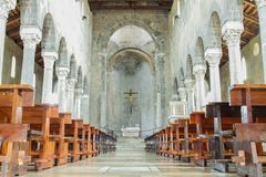 Inside the casertavecchia cathedral. Central nave with an altar and a crucifix Stock Photo