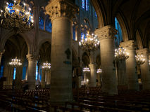 Inside the cathedral. Detail of a sumptuous gothic cathedral with beautiful stained glass windows and luxurious candelabra Stock Images
