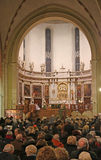Inside the cathedral with many worshipers during Mass for the op stock image