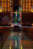Inside of Catholic church. Sunlight shines on an alter of a Catholic Church Royalty Free Stock Image