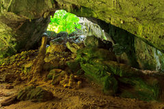 Inside cave with stone bridge above in Thailand Royalty Free Stock Image