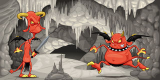 Inside the cavern with funny devils. Royalty Free Stock Images