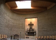 Germany Berlin Kapelle der Versohnung.Inside. Inside of the chapel.We see a big black cross. The upper part of the roof is a window. From here comes the stock image