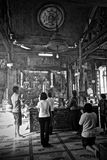 Inside of Chinese temple with a prayers. People in the Chinese temple royalty free stock photos
