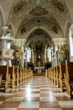 Inside of a church. With rows of benches Royalty Free Stock Photography