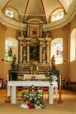 Inside of a church with altar and flower Royalty Free Stock Photos