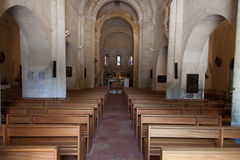 Inside a church benches and vaults Royalty Free Stock Photo