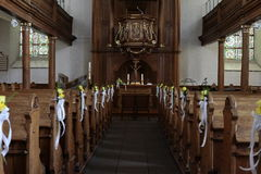 Inside a church. Catholic church from the inside. A church is decorated for a wedding Stock Image