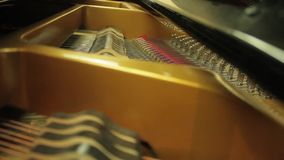 Inside of a Classical Piano as it is being played stock video