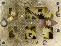 Inside the Clock. Gears inside an antique watch Royalty Free Stock Photography