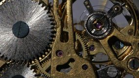 Inside a clock. Close up. Mechanical watch, working clock mechanism, moving metal gears inside working watch mechanism, clock mechanism, gears, gears mechanical stock video footage