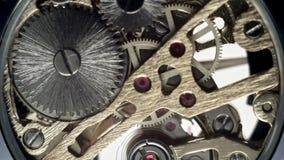 The inside clockwork of a wristwatch. Full HD stock video