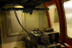 Inside CNC machining Center machine cutting part in Jig with coo Royalty Free Stock Photography