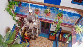 Inside of a colorful moroccan house, hotel in chefchaouen, Morocco royalty free stock photography
