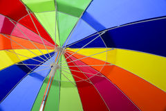 Inside a Colorful Umbrella. Looking up inside a multicolored umbrella. Colors are: red, orange, yellow, dark blue, light blue, green and purple. The colors are Royalty Free Stock Photo