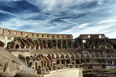 Inside of Colosseum. And dramatic sky - hdr Stock Photos
